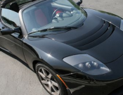 Arnold drives Tesla Roadster