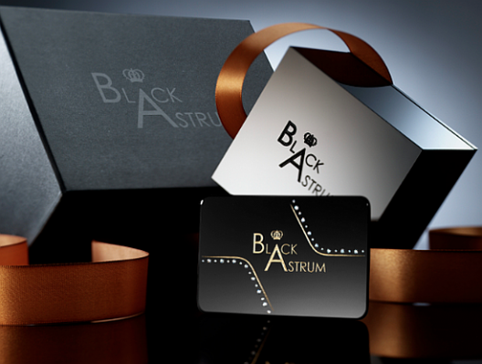Black Astrum business cards studded with diamonds are forever