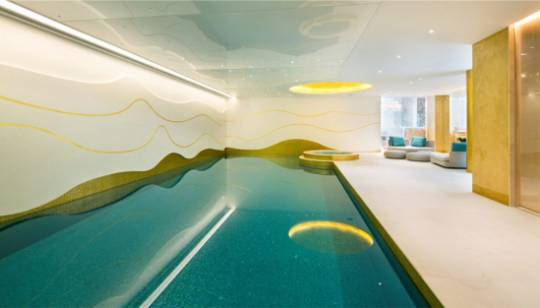 The 12-foot long personal swimming pool with side Jacuzzi