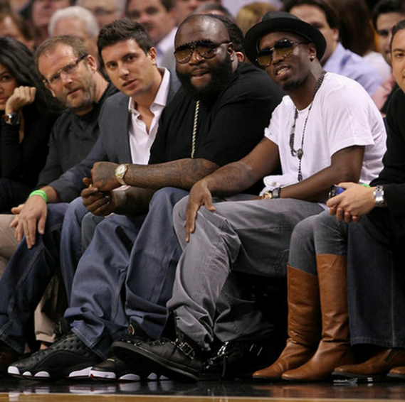 Rick can be spotted wearing his Air Jordan XIII (13) sneakers which gives him a sportier look.