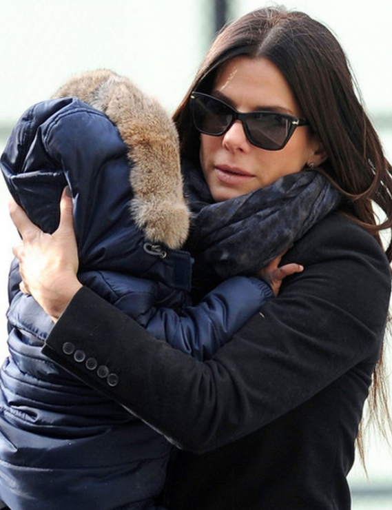 The actress was snapped donning these $220 designer shades while playing with her son Louis at a playground in New York.