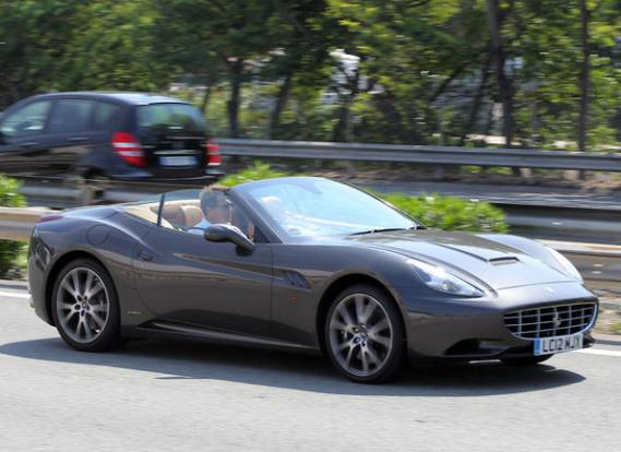 Hugh Grant drives Ferrari California