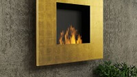 Planika Quadro Gold fireplace boasts a 24 carat gold flaked frame