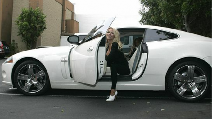 Pamela Anderson drives Jaguar XK