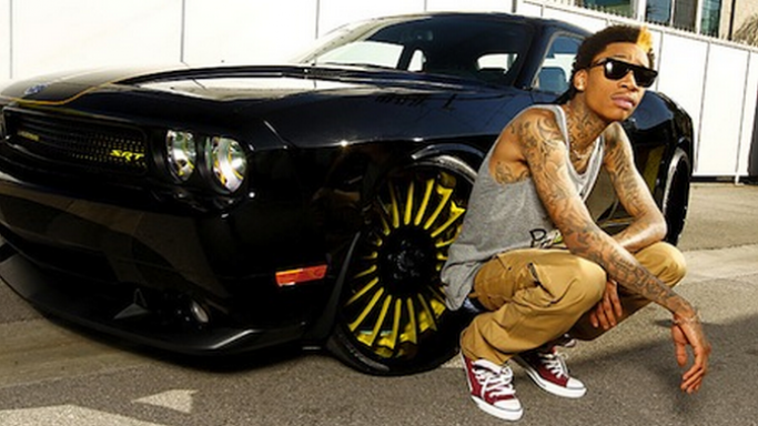 Wiz Khalifa is the proud owner of a black colored Dodge Challenger SRT 8