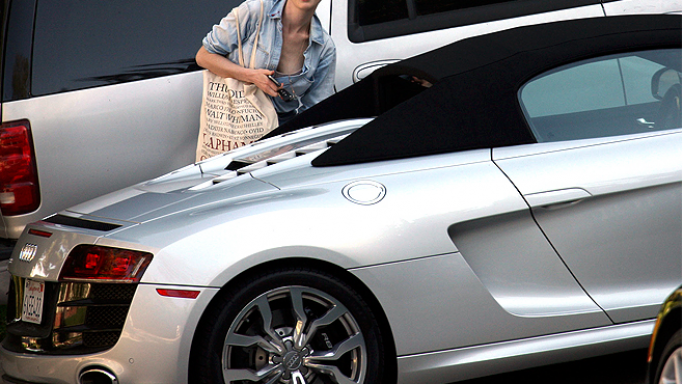 The actress loves driving around in her ice silver two-seater Audi R8