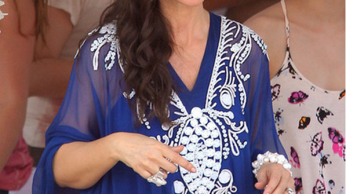 The actress donned her Christian Dior Embroidered Caftan on the set of 'Des Gens Qui S 'Embrassent' in St. Tropez France in 2012.