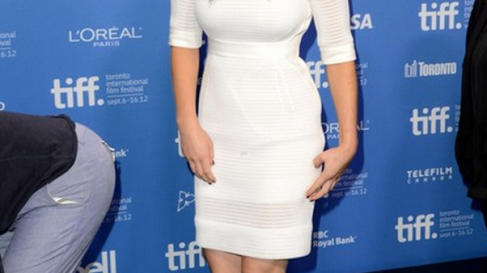 Jennifer Lawrence attended the photocall for the Silver Linings Playbook at 2012 TIFF wearing a stunning white sheath dress.
