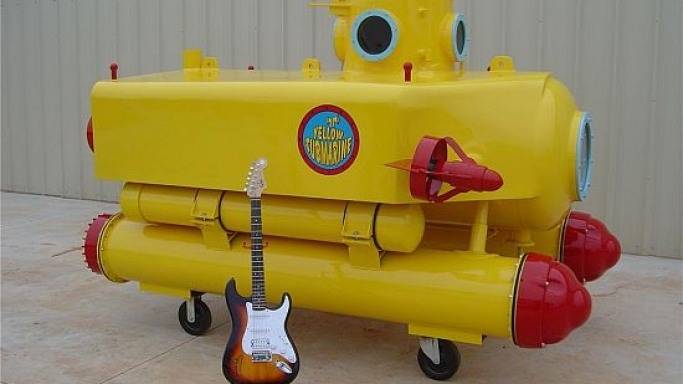 Barrett-Jackson classic yellow submarine comes with an electric guitar signed by Sir Paul McCartney