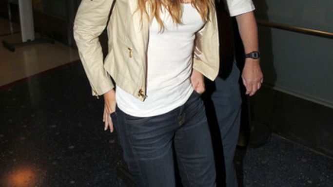 Stylish actress has been spotted wearing Alice Olivia Graham Hooded Biker Jacket several timesand recently at LAX airport.