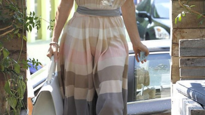The actress visited an upscale California restaurant wearing this lustrous dress.